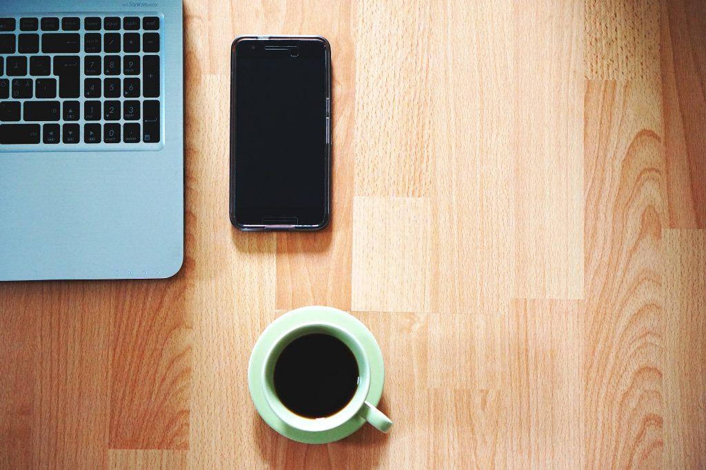 Coffee, computer, and phone