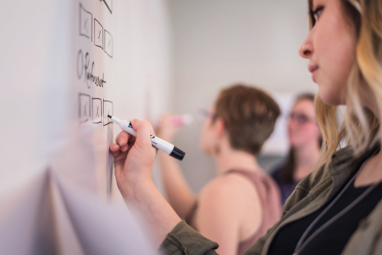 Women writing on a whiteboard